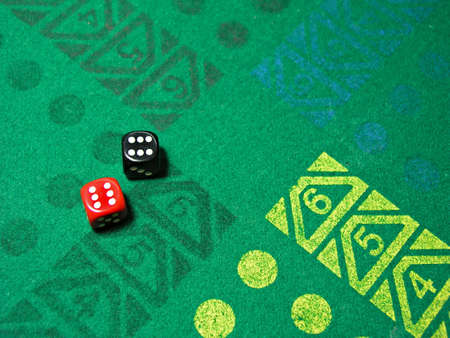 two dice with number six in green table game photo