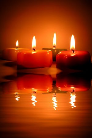 wicks: christmas candles and reflection in water Stock Photo