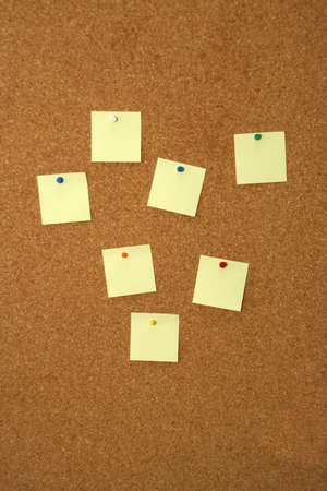 cork board with seven empty yellow notes Stock Photo - 2053873