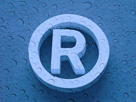 registered: Registered trademark in a blue background with water drops Stock Photo