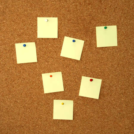 square cork board with seven empty yellow notes Stock Photo - 2429242