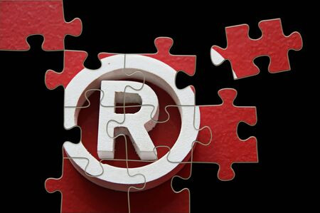R Registered trademark - puzzle incomplete
