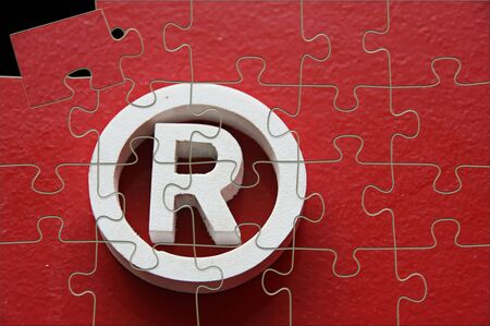 registered: Registered trademark in a red background - puzzle one piece out