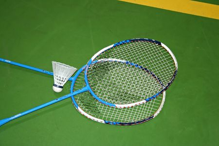 detail of two badminton rackets in the green floor of the gym Stock Photo - 2947135