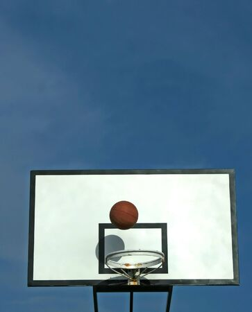 ball in basket in old basketball table - sport symbols photo