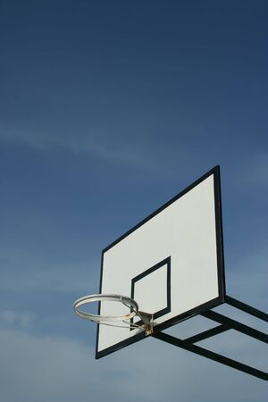 basketball basket in blue sky photo
