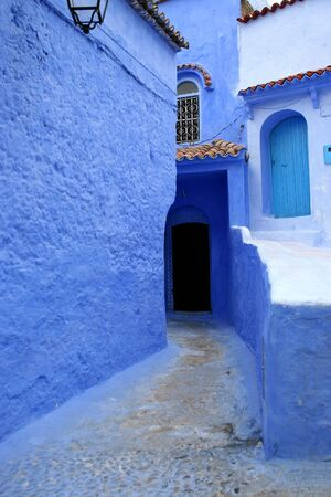 detail from typical street in chefchaouen, in north of morocco photo