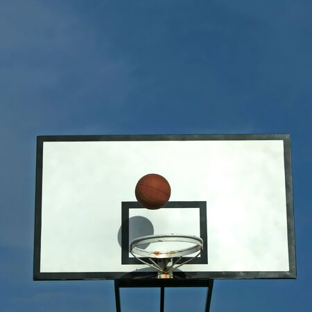 ball in basket in old basketball table - sport symbols - square format photo