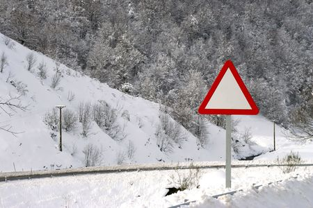 danger empty traffic signal in snow covered road - winter landscape photo