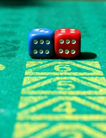 two dice with number six in game table - focus on the dice photo