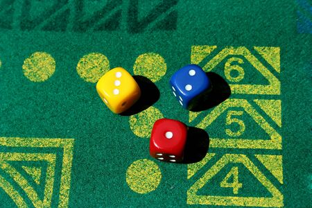 three dice with number one, two, three in green table game photo