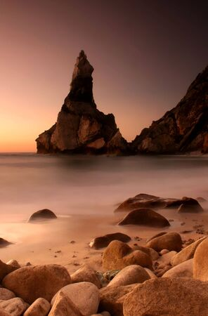 roca: magic sunset in ursa beach near cape roca in portuguese coastline - long exposure