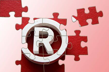 incomplete: R Registered trademark - puzzle incomplete - illustration