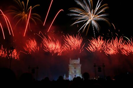 colored fireworks in the night in lisbon near tower belem, portugal Stock Photo - 3800872