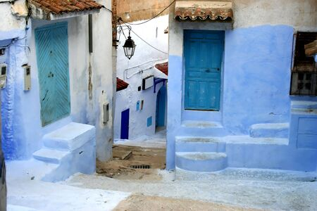 detail from old typical street in chefchaouen, in north of morocco photo