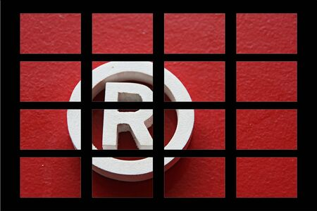 square puzzle of Registered trademark - illustration Stock Photo