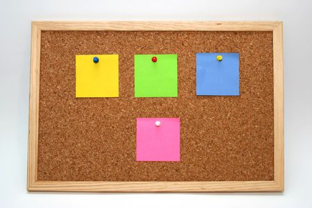 cork board with colored notes in white background photo