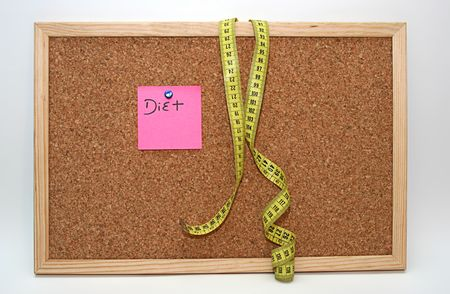 Diet note and metric tape in cork board Stock Photo - 3936966