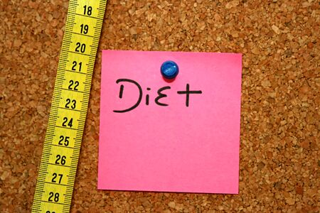 Diet note and metric tape in cork board Stock Photo - 4191705