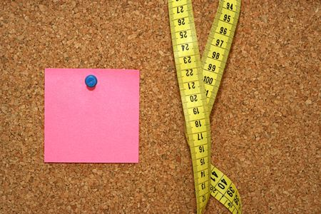 Diet note and metric tape in cork board Stock Photo - 4229774