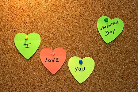 heart notes with love messages in cork board Stock Photo - 4268823