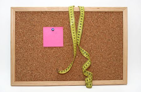 Diet note and metric tape in cork board Stock Photo - 4343816
