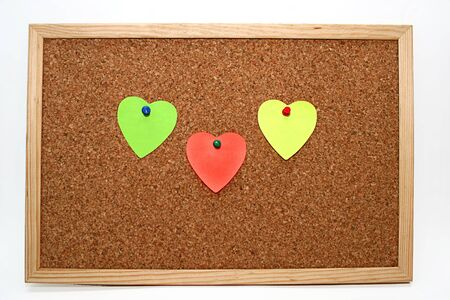 three heart notes in cork board photo