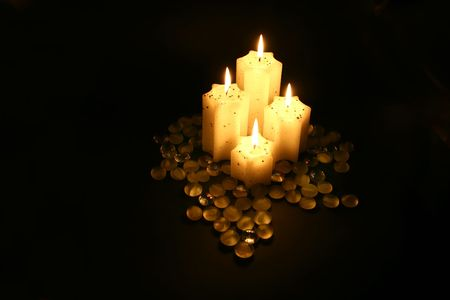 four candle in black background with warm light Stock Photo - 4484817