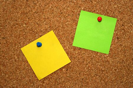green and yellow note in cork board Stock Photo - 4579937