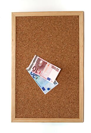 cork board with 10 and 20 euro notes