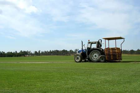green grass field in alentejo with agricultural tractor Stock Photo - 4732132