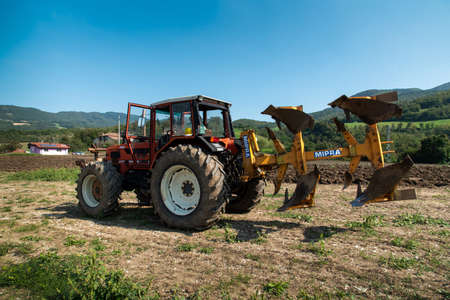 September 2020, Calestano province of Parma, Italy. galaxy same tractor plowing a field