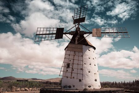 Historic Windmill, Lanzarote, Spain. background or wallpaper with copy space. Graduated filter blue sky and rural landscape.