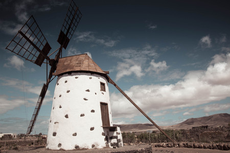 Historic Windmill, Lanzarote, Spain. background or wallpaper with copy space. Blue sky and rural landscape. Archivio Fotografico