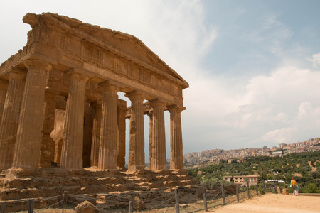 The facade of the Temple of Concord, with no people and blue sky. Temples Valley, Agrigento, Sicily.