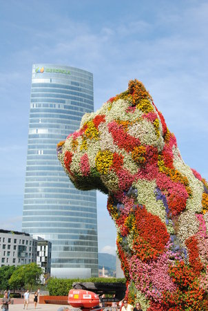 BILBAO, SPAIN - CIRCA AUGUST 2012 - the famous topiary sculpture The Puppy by Jeff Koons, located in Plaza Aguirre, Bilbao. It is comprised of thousands of flowers and was inaugurated in 1997.