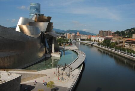 Panorama of the Guggenheim Museum of Bilbao with the spider sculpture Maman by artist Louise Bourgeois, located on the Nervi?n river. Editorial