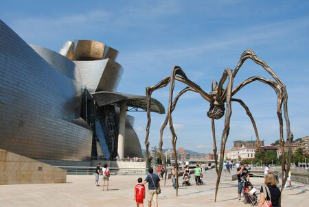 Front view of the Guggenheim Museum of Bilbao with the spider sculpture Maman by artist Louise Bourgeois, located on the Nervi?n river.