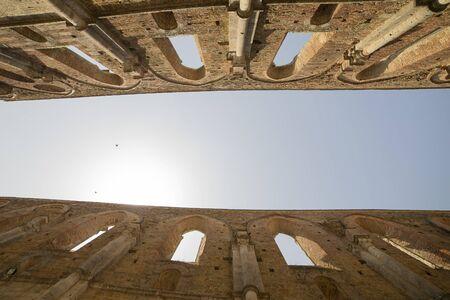 Summer sky betwen the walls of the roofless gothic San Galgano abbey. Tuscany, Italy.