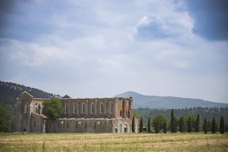 Distant landscape view of san galgano abbey under the blue sky. Tuscany, Italy.