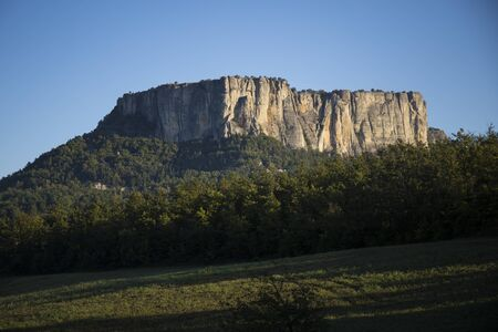 The stone of Bismantova, an isolated impressive spur in the italian appenines region. Morning view.
