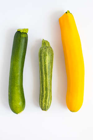 Metaphor, symbol of multiracial, interracial family composed by three zucchini in different variety and colors. Vertical shot. Reklamní fotografie