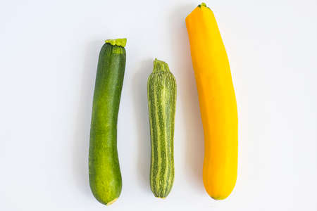 Metaphor, symbol of multiracial, interracial family composed by three zucchini in different variety and colors. Reklamní fotografie