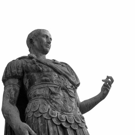 A bronze roman statue of Iulius Caesar in Turin, Italy isolated over white photo