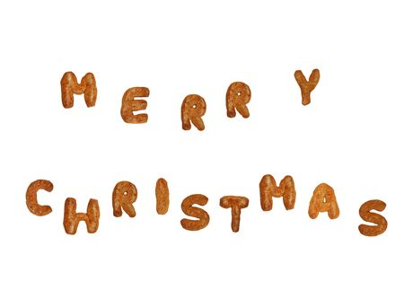 Merry Christmas written with gingerbread biscuits photo
