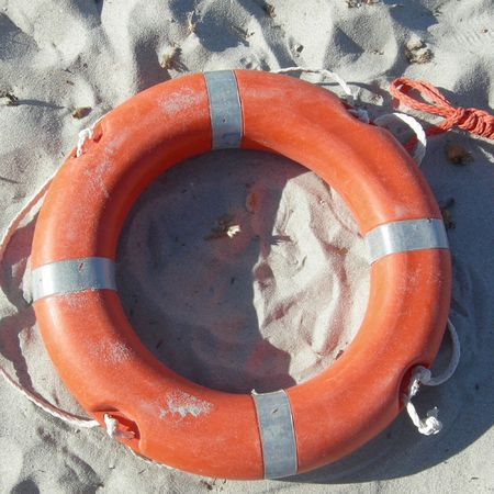 Isolated orange life buoy photo