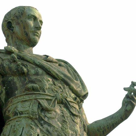 A bronze roman statue of Iulius Caesar in Turin, Italy isolated over white photo