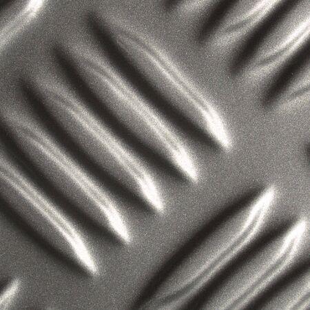 sampler: Bumped diamond steel sampler Stock Photo