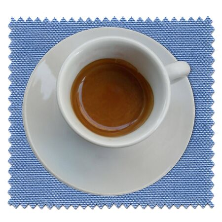 bar ware: A cup of coffee over a blue tablecloth