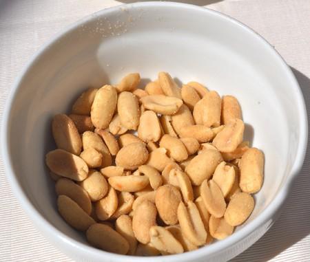 pygmy nuts: Peanut dry fruit or groundnut (Arachis hypogaea) beans Stock Photo